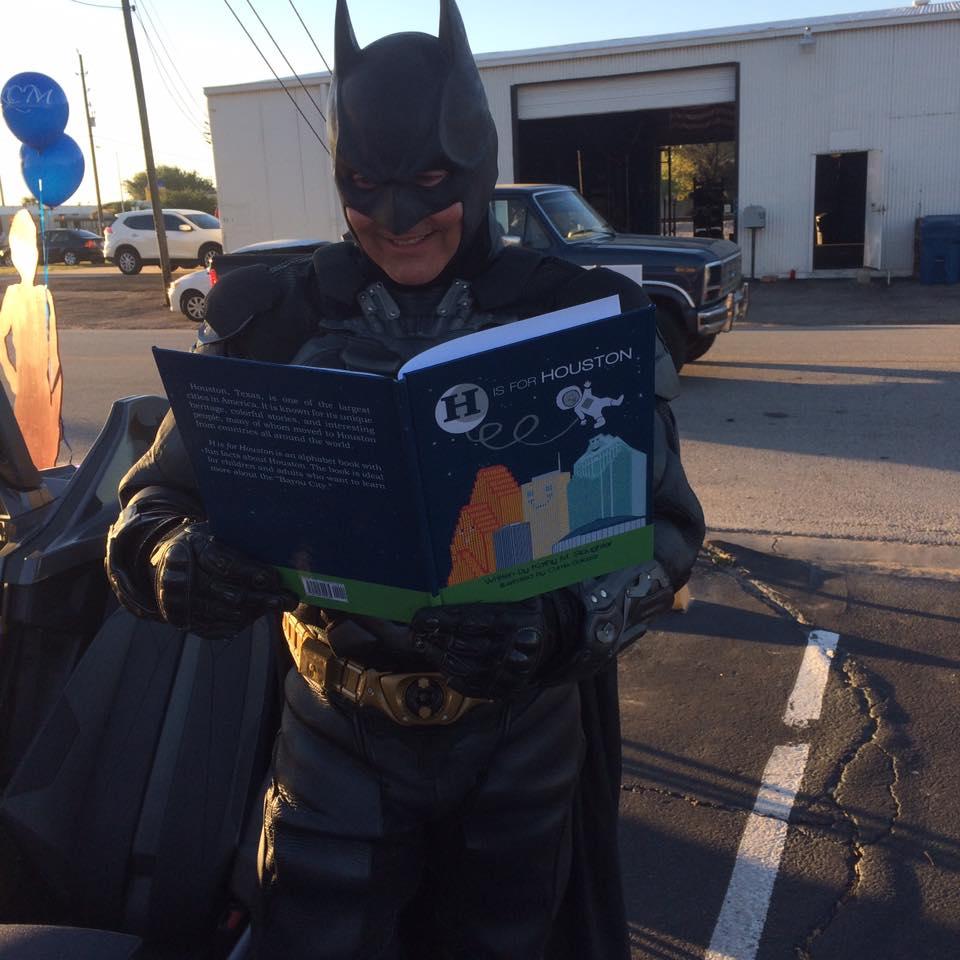 Batman enjoys reading H is for Houston!