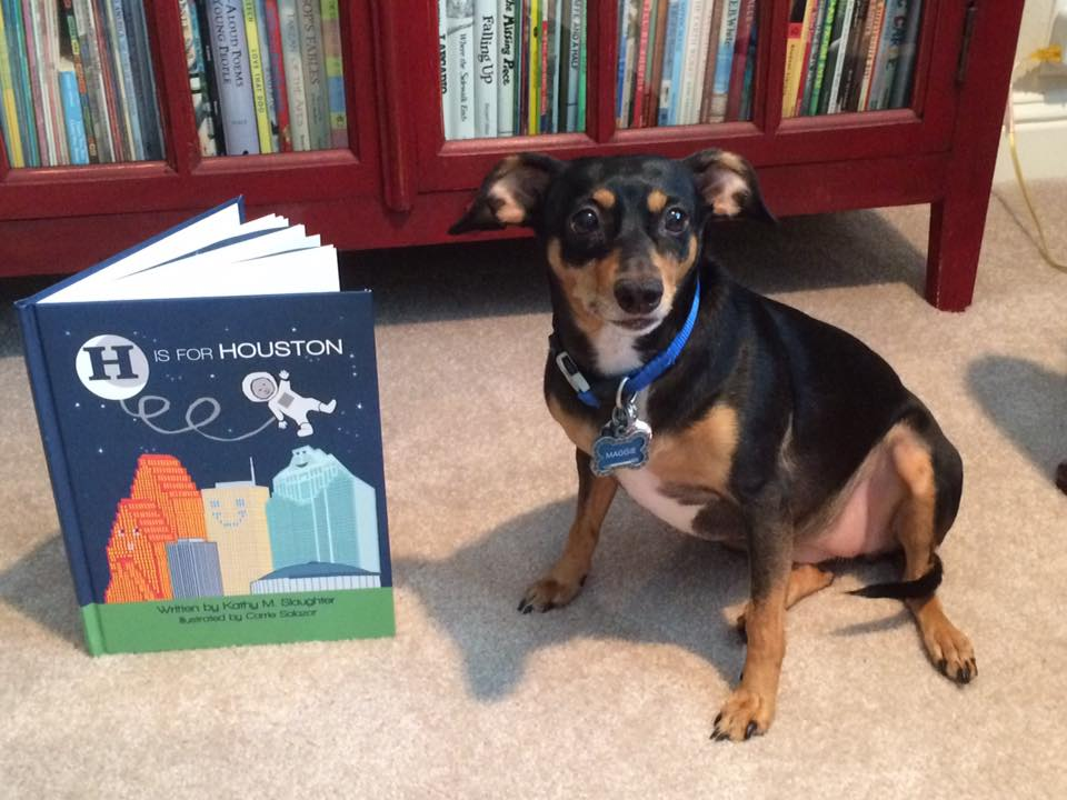 Maggie the Min Pin enjoys reading H is for Houston!
